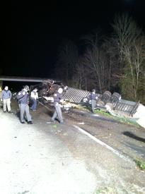 Overturn truck with the Riverhill Road Bridge in the back ground