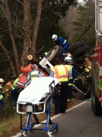 EMS crew watches as crews work to extricate the truck driver.