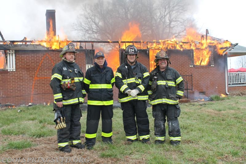 "Deputy Chief Groff, Photographer and former Fire Chief Maurice ""Mo"" Jenkins, Engineer and Former Fire Chief Steve Mayes and Fire Chief Webster."